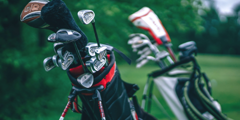Close up of golf clubs in golf bag