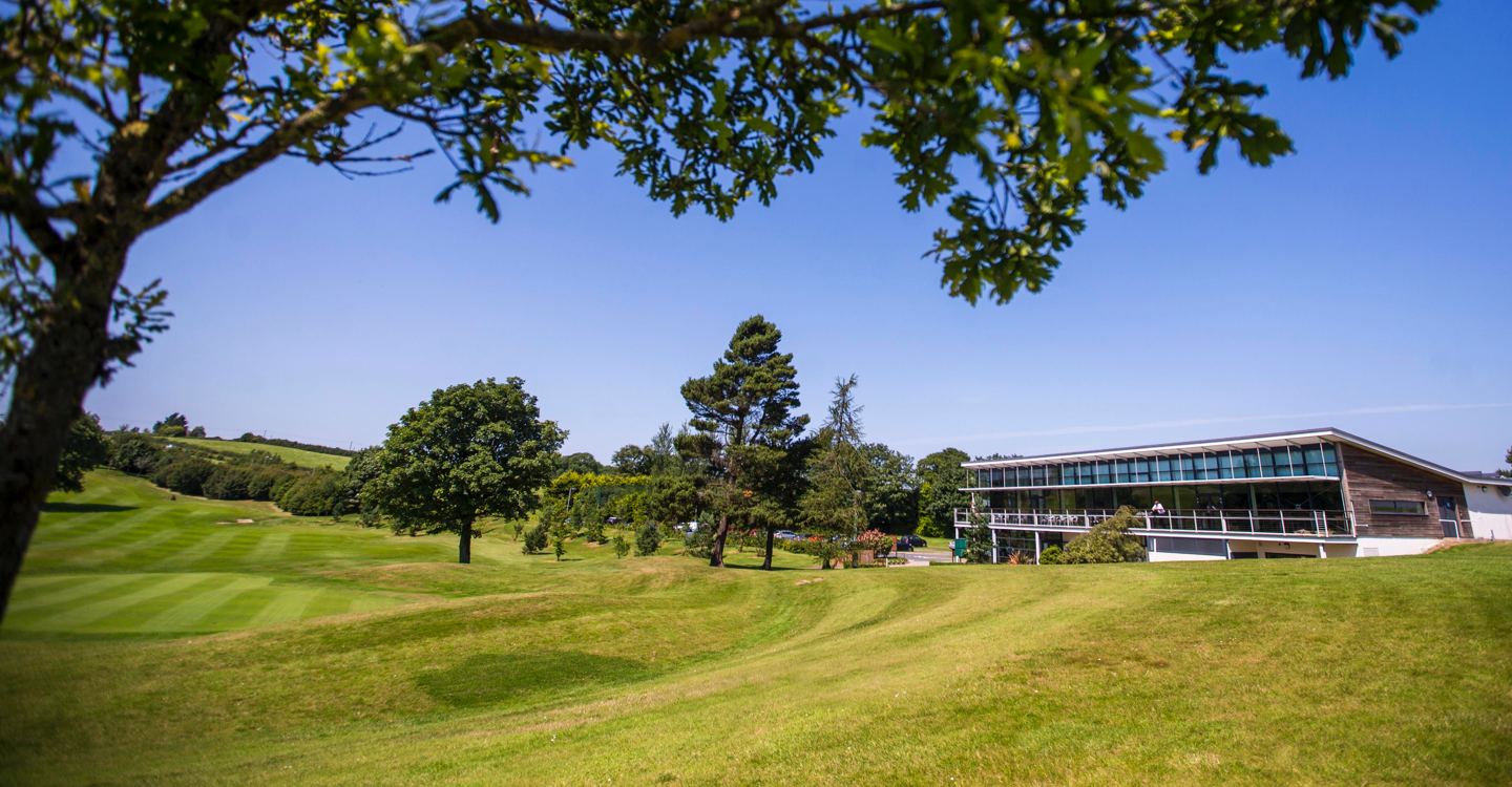 Wide angle view of club House and golf course